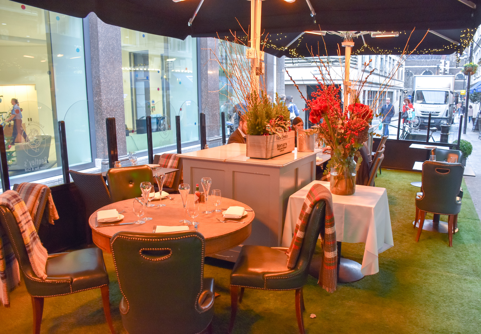 A festive afternoon on the terrace at bentley 39 s oyster bar for The terrace bar and grill